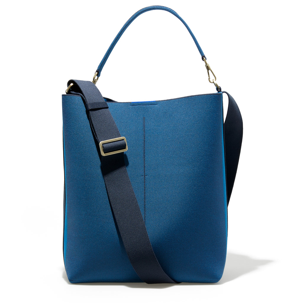 The Bucket Bag in Deep Sapphire shown from the front.
