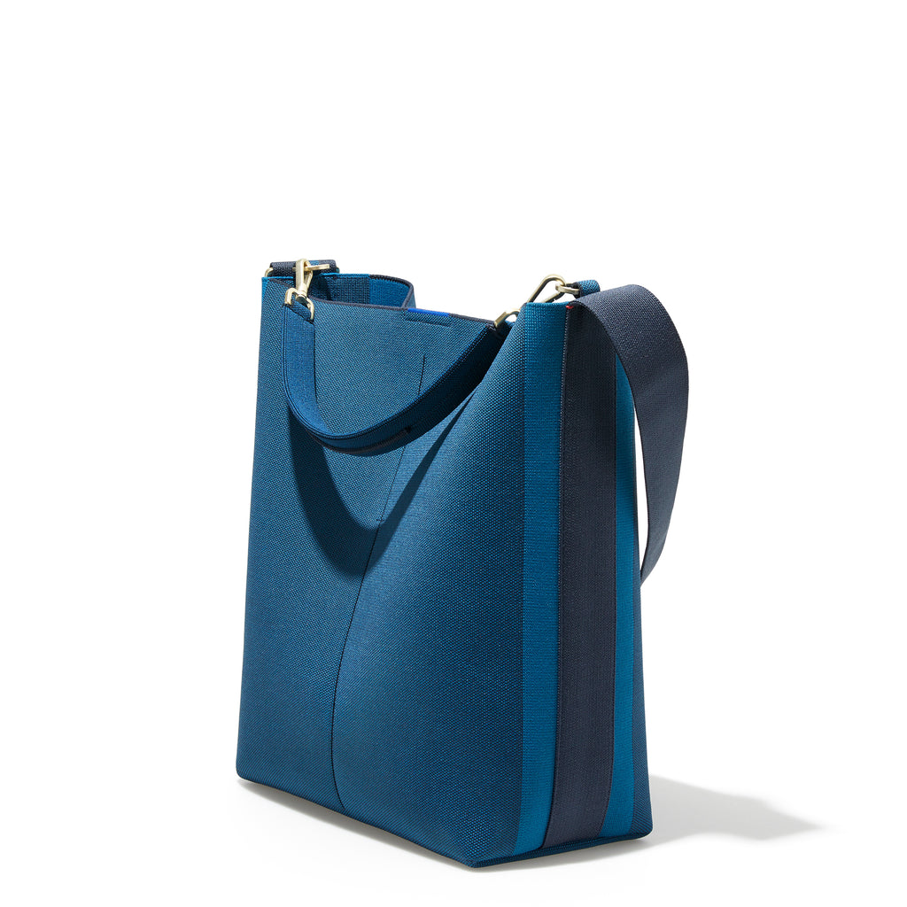 The Bucket Bag in Deep Sapphire shown in a diagonal view.