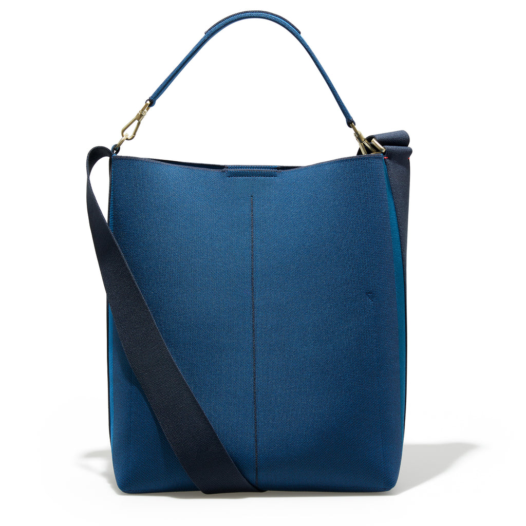 The Bucket Bag in Deep Sapphire shown from the back.