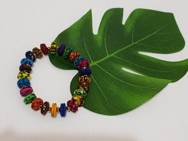 Handmade small colourful African fabric bracelet
