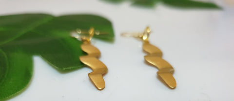 Medium squiggle shaped brass Earrings