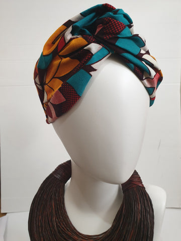 Multi-coloured brown, red and gold wide African print turban style headband