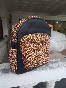 Black and leopard print handmade Leather and African print backpack