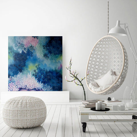 Large Square Blue Turquoise Pink and Yellow painting on Canvas inspired by underwater coral gardens 76 x 76 cms created by Rebecca Coulter Underwater Garden III insitu with hanging chair