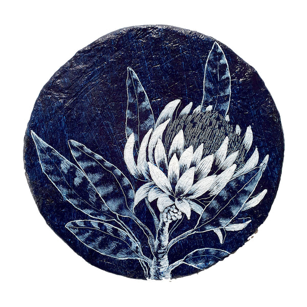An original painting inspired by Waratahs and Proteas in blue and white on a handmade paper porthole. Original one of a kind art created by Rebecca Coulter