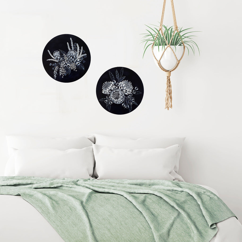 Modern Australian Coastal style Bedroom setting featuring two round Porthole paintings of Australian wildflowers painted in blue and white on circular timber panels.