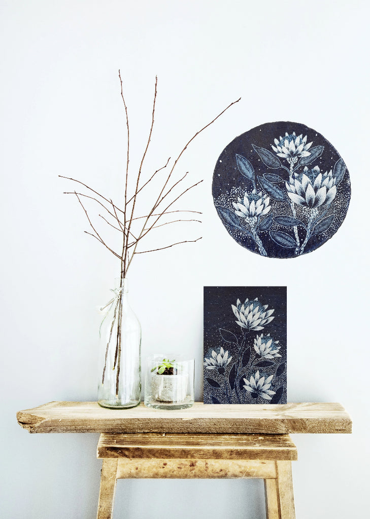 Australian native flowers inspired by paper daisies and flowering gums Dark Blue White paper porthole painting resting on a timber stool Original one of a kind Australian Art