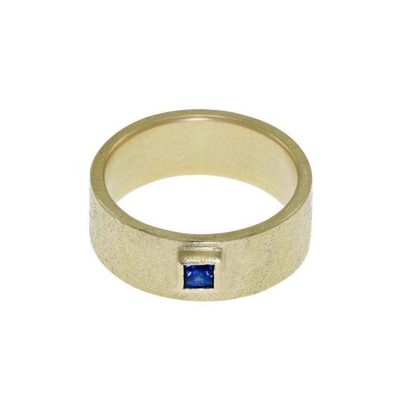 Mens gold band with sapphire