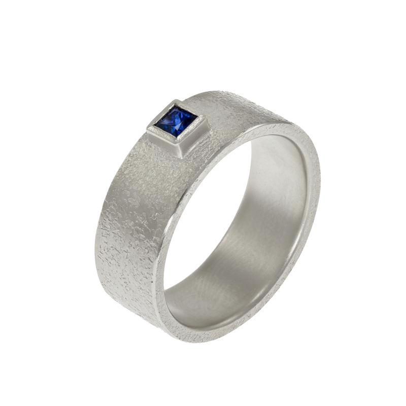 Mens white gold band with sapphire