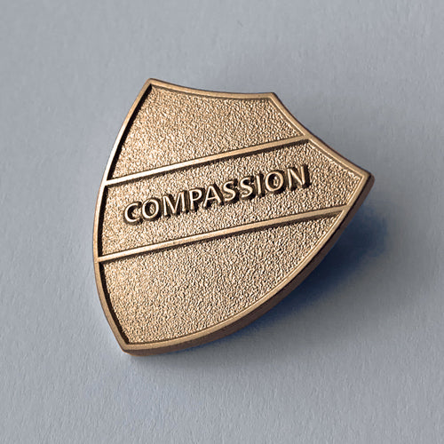 Gold Compassion Metal Shield Badge **SALE ITEM - 50% OFF** by School Badges UK