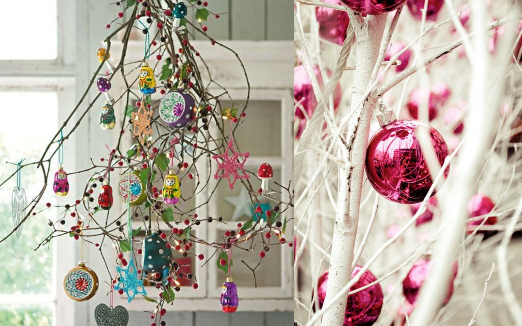 Coloured festive baubles on white branches - Christmas decorations