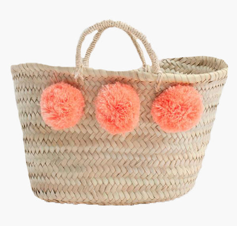 Handwoven sustainable basket with colourful pom poms