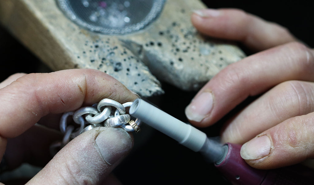 Diana Porter hand made chain process, sanding the links