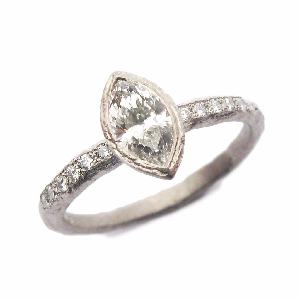 diana porter jewellery marquise cut diamond set in textured fairtrade white gold with tiny diamonds pave set either side