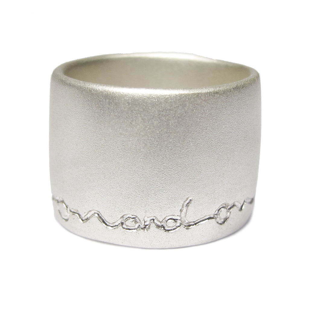 wide silver ring etched on and on by Diana Porter contemporary Jeweller