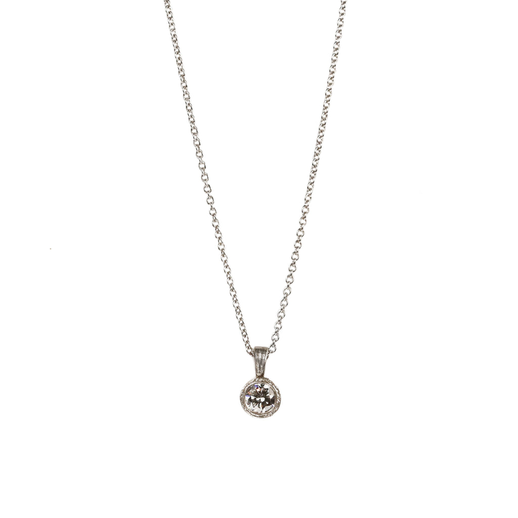 Platinum Etched Pendant Set with a Diamond on Platinum Chain