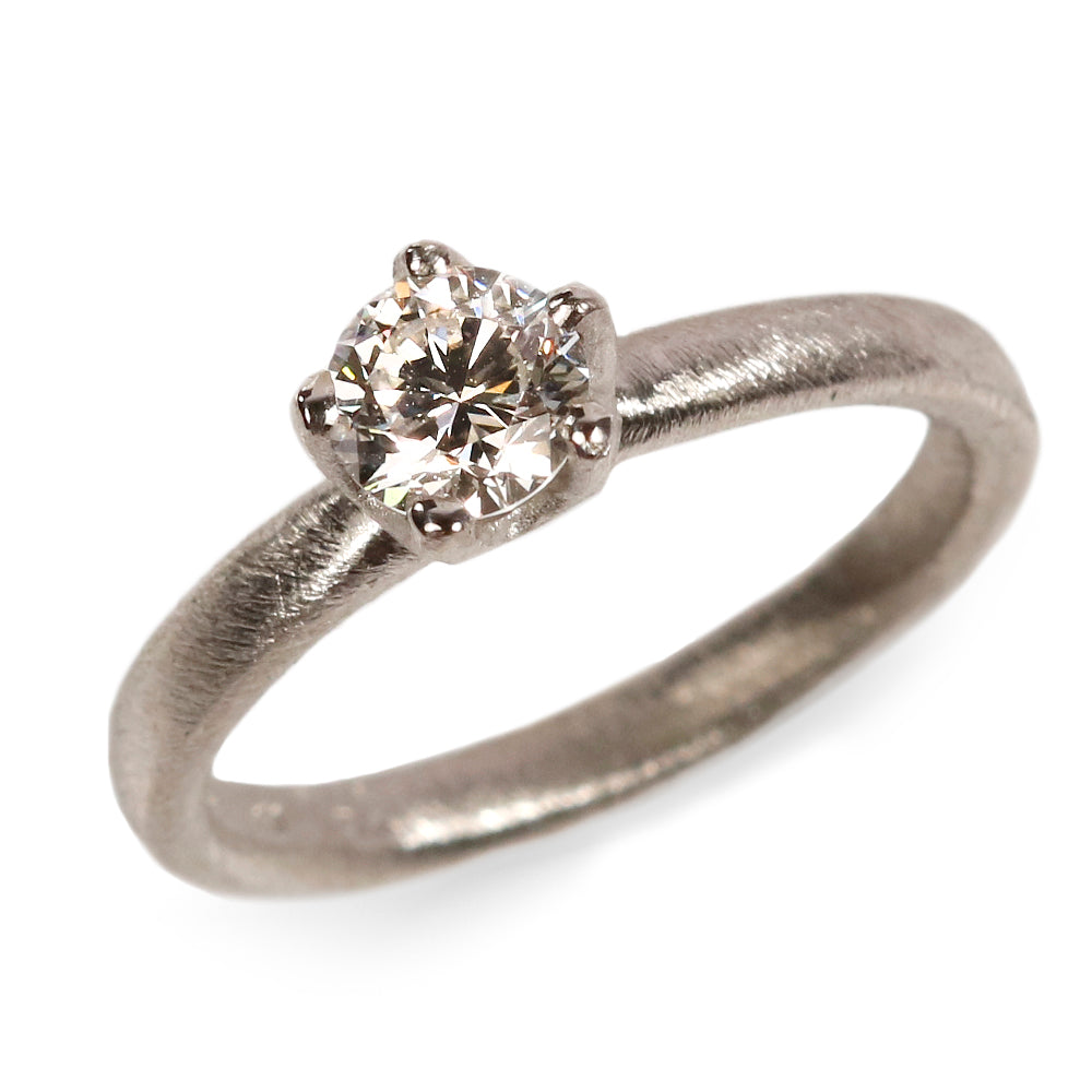 Platinum Ring Set with a Brilliant Cut Diamond in an Irregular Claw Setting