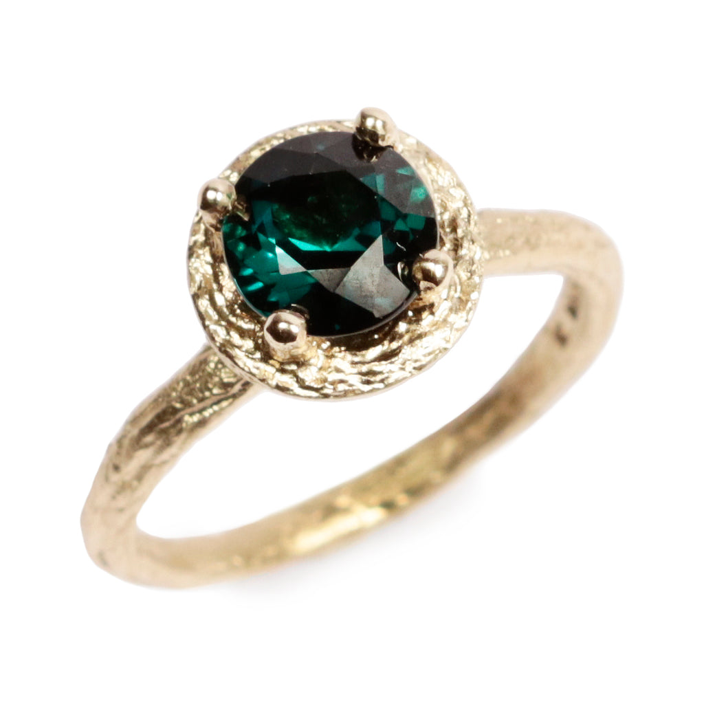 Diana Porter Fairtrade Yellow gold Textured Engagement ring with Blue Tourmaline in raised claw setting with gold halo Ring
