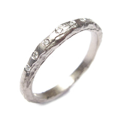 Slim, Textured Platinum Ring with 8 Diamonds