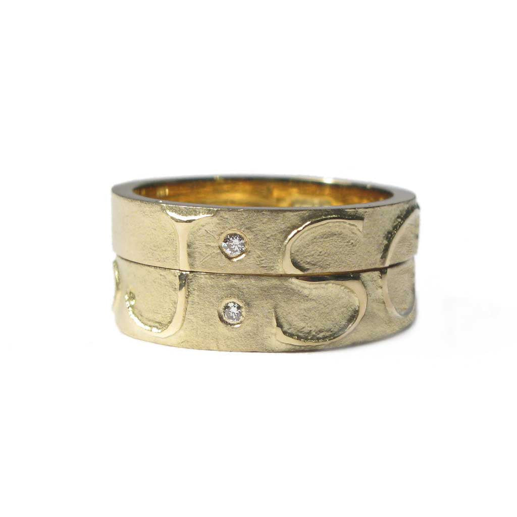 Diana Porter Jewellery bespoke commission etched yellow gold diamond partnership rings