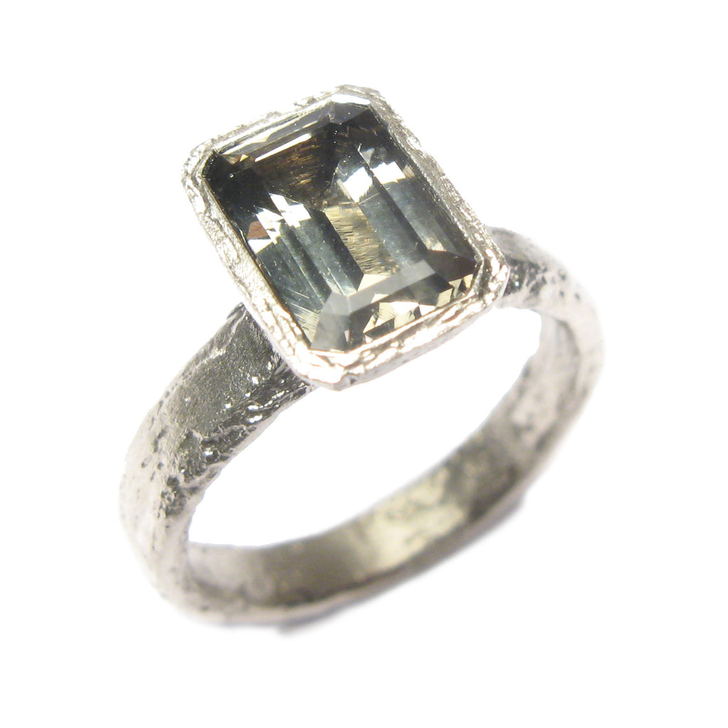 9ct white gold ring with customers own, emerald cut Zoisite.