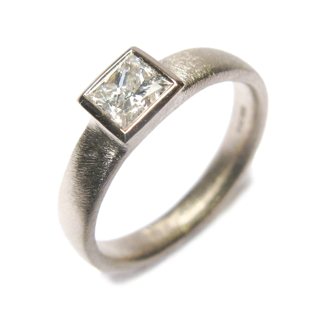 18ct White gold ring. Based on the AOJTNPC, adapted to take customers own princess cut diamond.