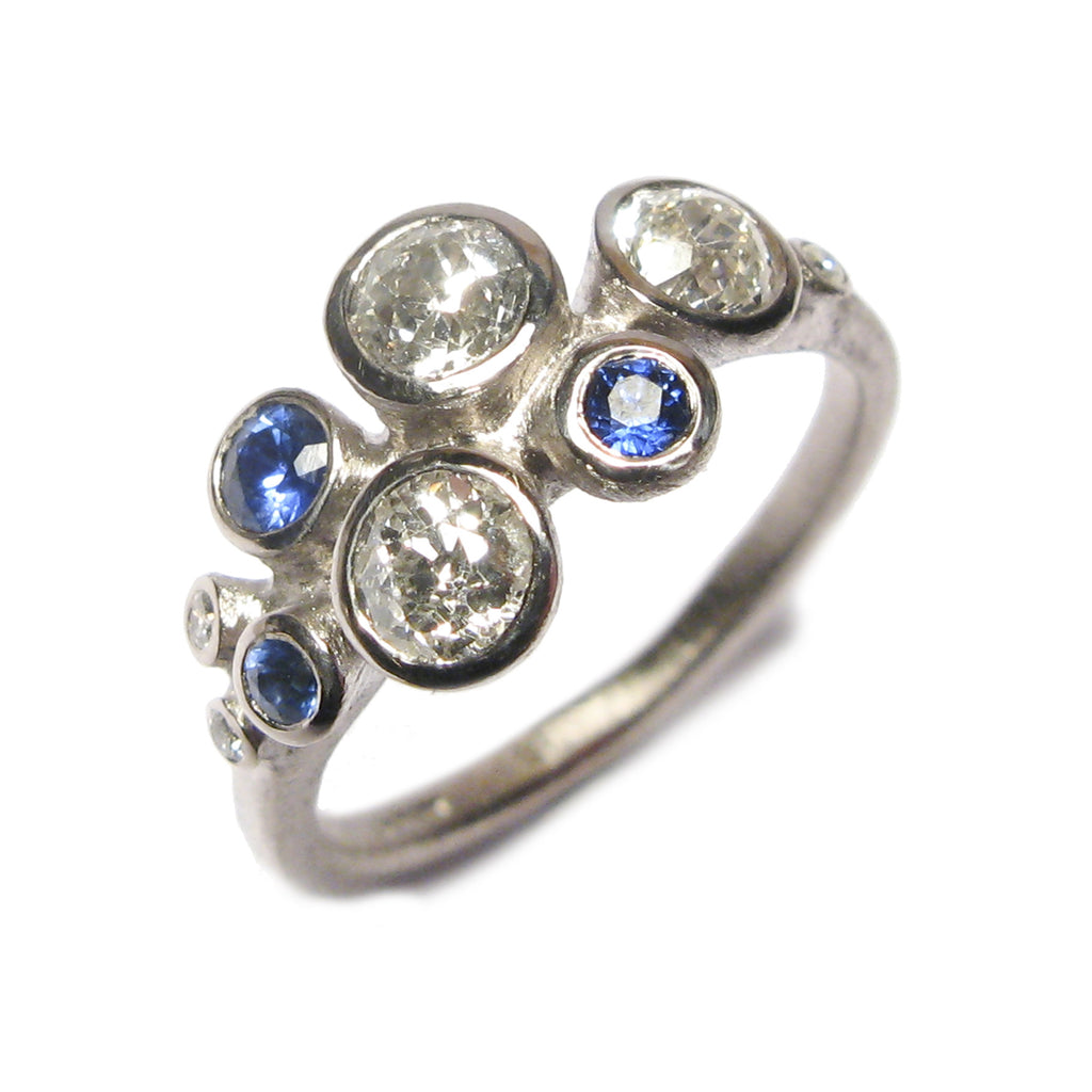 Commissioned bespoke multi set 18carat white gold ring with three diamonds and 3 dark blue sapphires