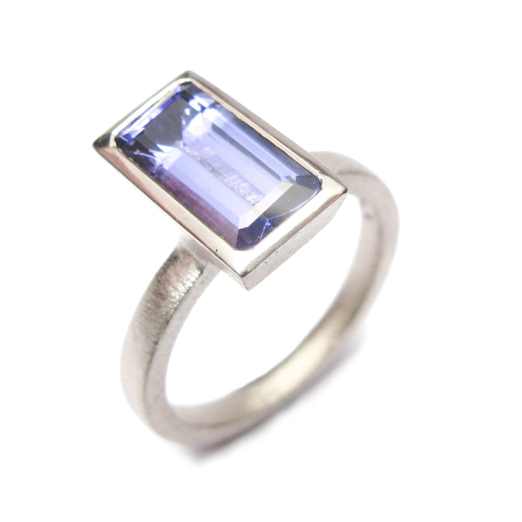 bespoke commissioned 18ct white gold ring with customers own, emerald cut, tanzanite