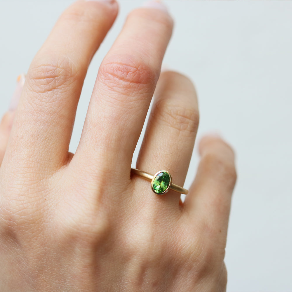 18ct Yellow Gold Ring With an Oval Tsavorite Garnet