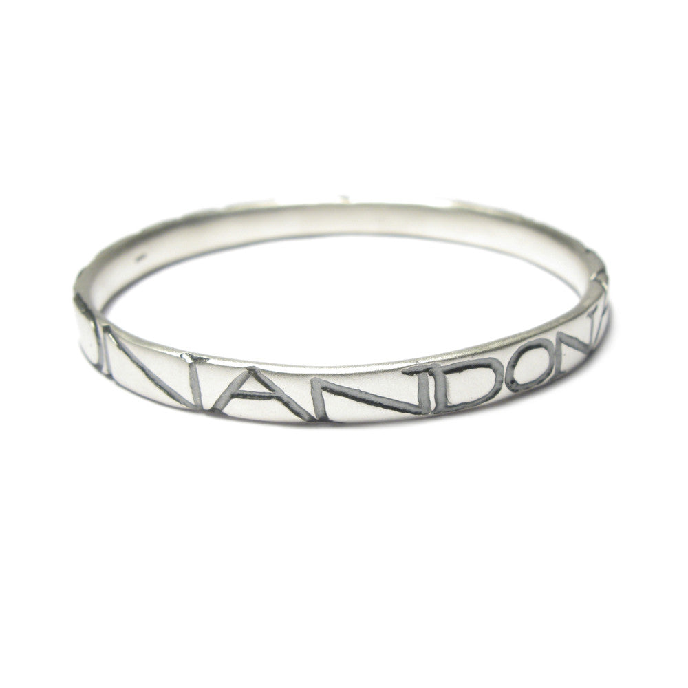 Diana Porter etched on and on silver bangle