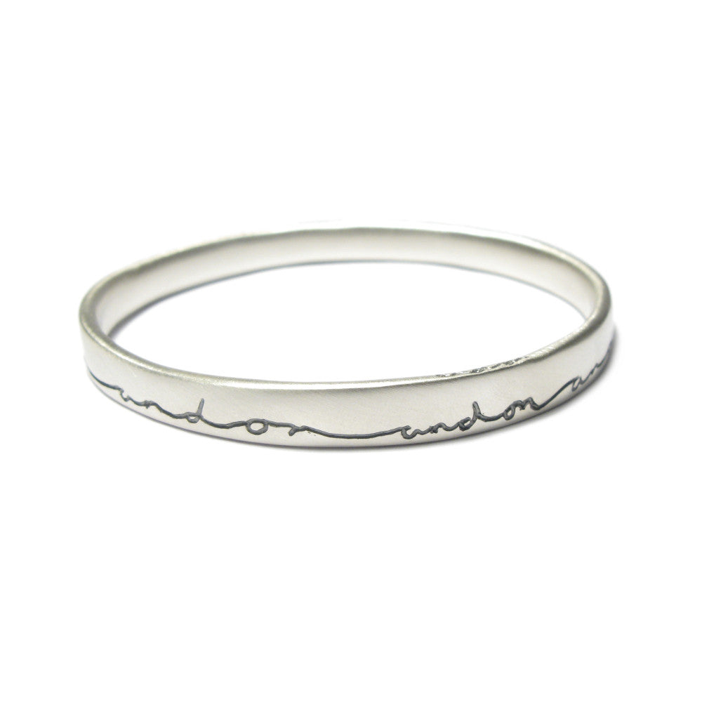 Diana Porter contemporary etched on and on silver bangle