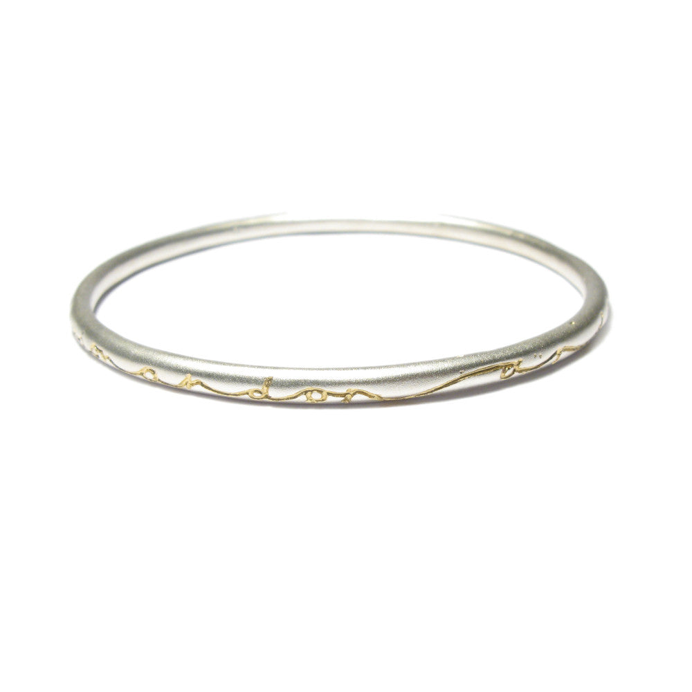 Diana Porter etched on and on silver gold bangle
