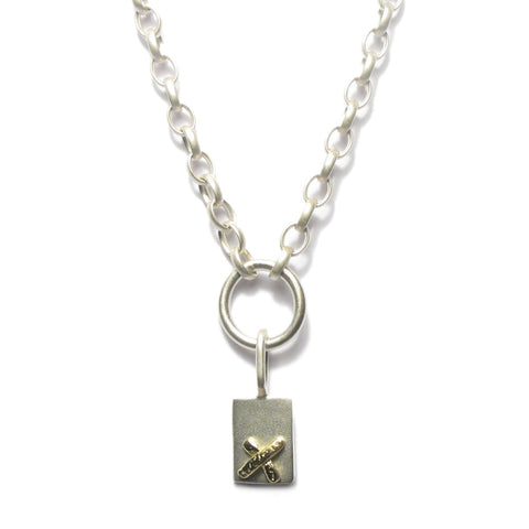 Silver and Gold Kiss Charm Necklace