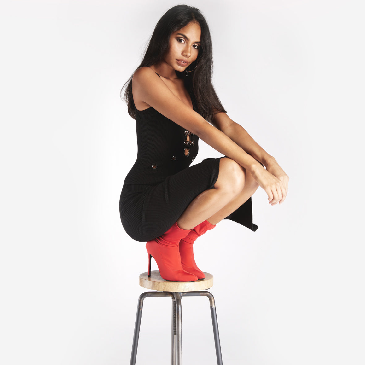 black bodycon dress with red sock boots