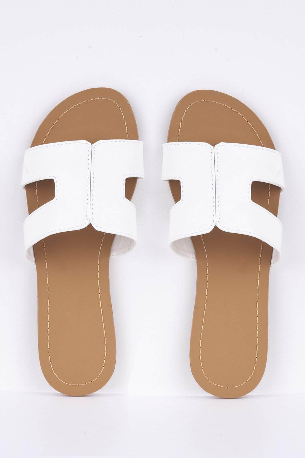 White Pu Cut Out Sliders by Hidden Fashion