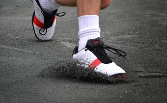 Tennis Player Slides on a Har-Tru Clay Court