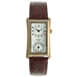 long rectangle shaped watch gold plated with silver face, brown leather strap