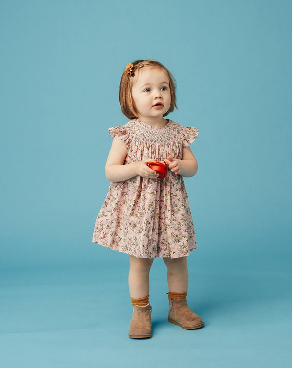 toddler wearing frill neck dress