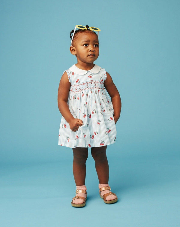 girl in cherry print baby dress