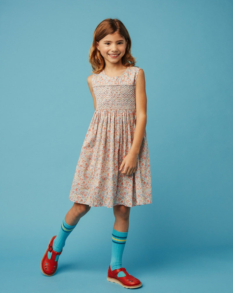 girl in hand smocked Liberty dress
