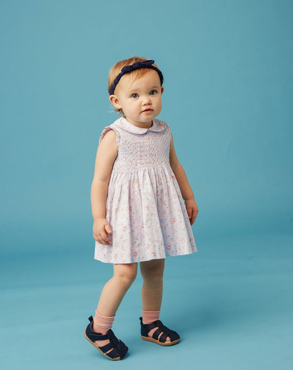 toddler in smock dress