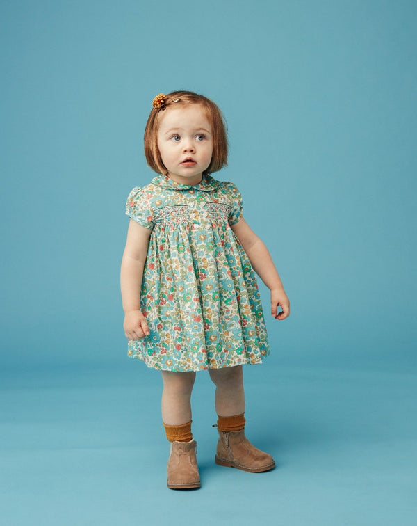 toddler girl in classic Liberty smocked dress