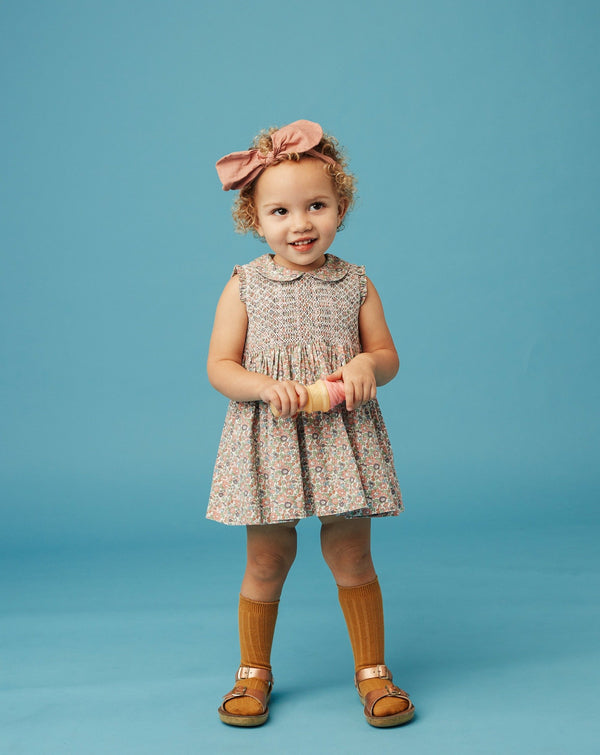 toddler in hand smocked dress