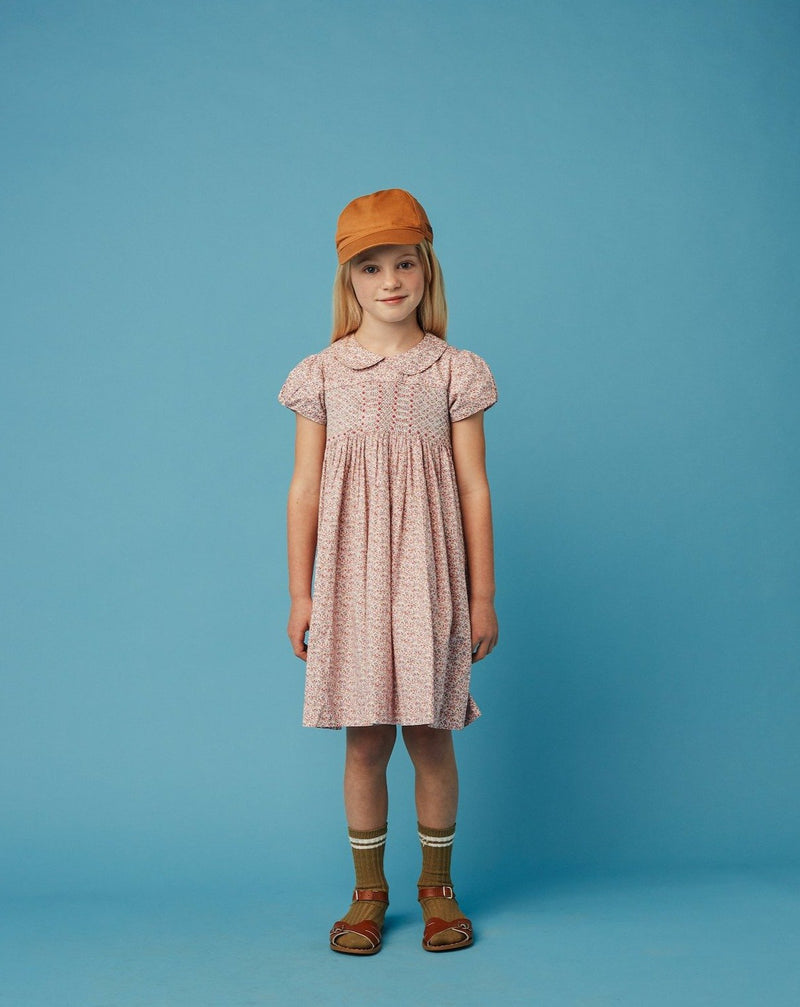 girl in classic hand-smocked dress