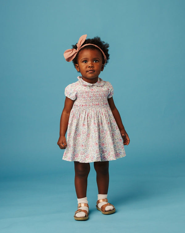 baby girl in smocked Liberty dress