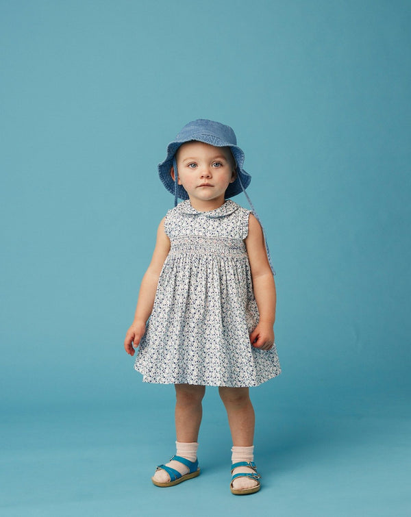 girl in floral baby dress