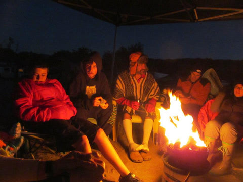 friends gathered around the campfire