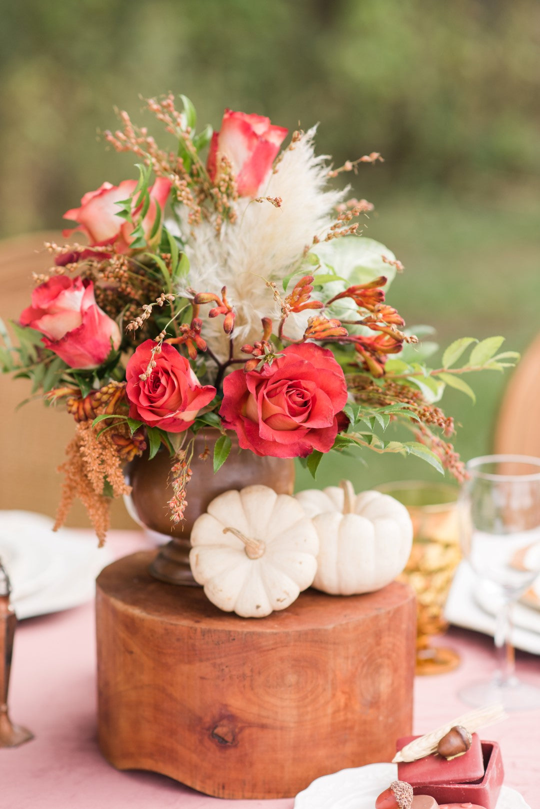 Flowers and pumpkins at a fall wedding