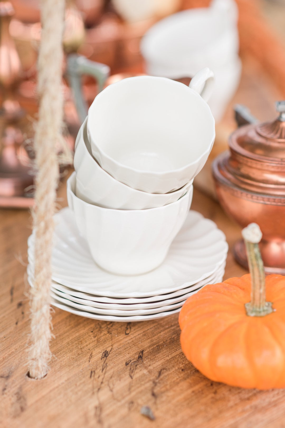 vintage coffee cups and small pumpkins