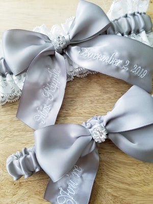 White Lace and Silver Satin You're Next Bridal Garter Set